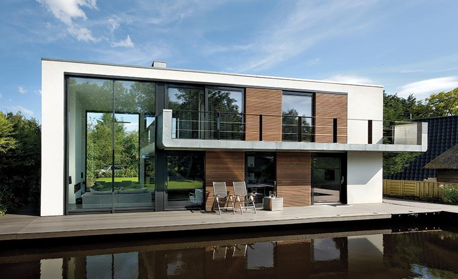 The waterstudios villa de hoef in the netherlands normally sits on dry ground alongside a waterway but when it floods the house floats